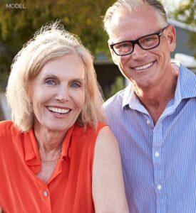 Mature Couple Smiling at Camera