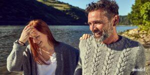 Mature couple on a lake smiling